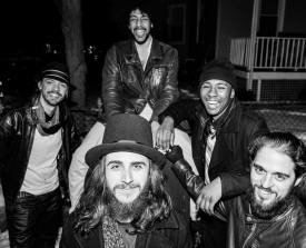 The Frotations after a basement concert at an undisclosed location back row from left to right: Vincius Da Silva ( Guitar), Chris Kazarian ( Lead Vocals), Shawn Dustin ( Drums); Front: Joao Noguiera ( Keys), PEdro Zappa( Bass)