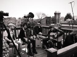 The Frotations on a Roof Top From Left to Right: Marco Perfetti( Background Vocals), Chris Kazarian(Lead), Pepe Hidalgo Ramos( Cajon/Drums), Vinicius Da SIlva( Acoustic Guitar)